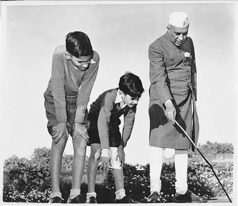 Jawaharlal Nehru during an informal botany lcass with his grandsons, Rajiv and Sanjay Ghandi Homai Vyarawalla 1950, silver gelatine print