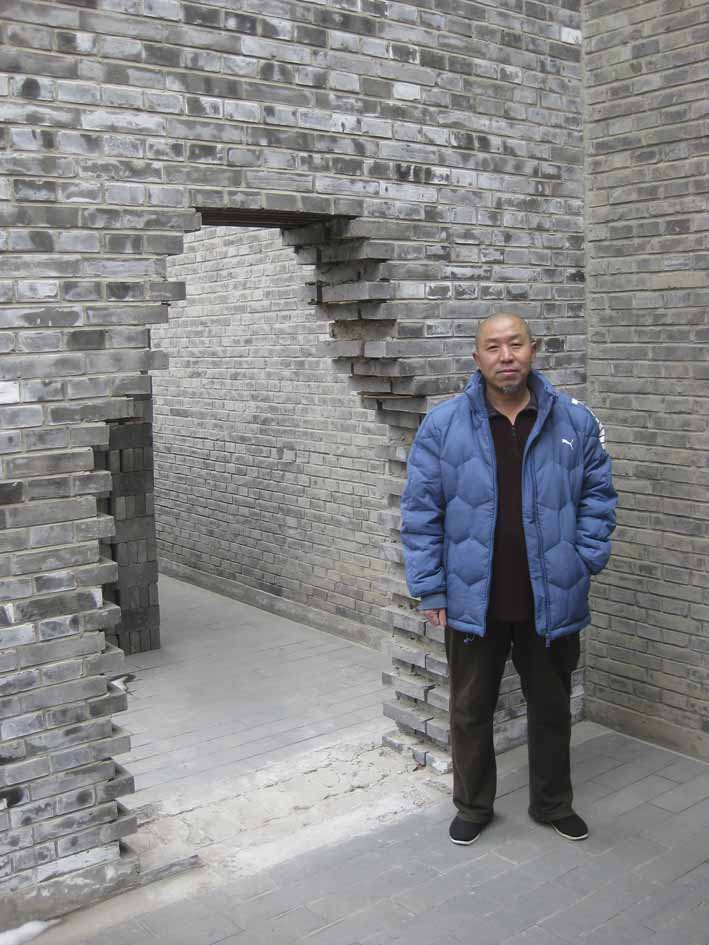 Yang Zhichao in March 2014 in the courtyard of his Beijing studio/home designed by his friend Ai Weiwei. Photograph: Michael Young