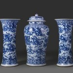 Garniture with scenes of West Lake, porcelain painted with cobalt blue under a transparent glaze, circa 1700, Qing dynasty (1644–1911), jars height 40 3/4 in, vases height 35 5/8 in, R Albuquerque Collection