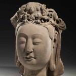 Head of a Bodhisattva, Northern Qi dynasty (550-577), sandstone, height 31.75 cm, unearthed in 1954 from Huata Temple in Taiyuan, Shanxi. Collection of the Shanxi Museum