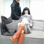 Cui Xiuwen In her Beijing studio with Tracey the doll.