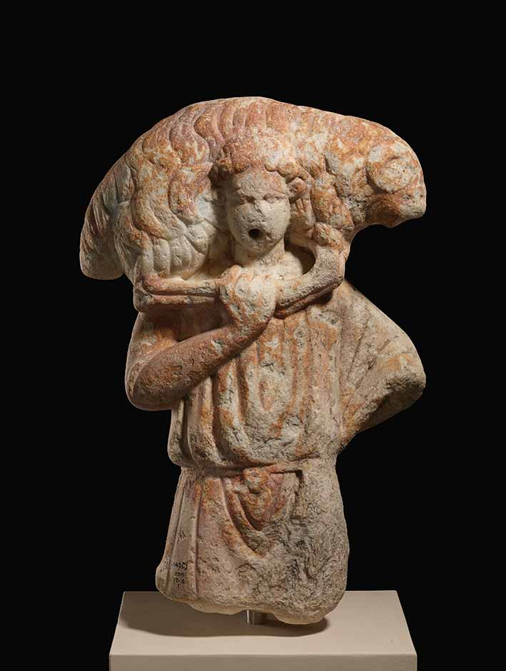 Statue of a Ram bearer, 3rd-4th century, marble, Zubeir, Iraq. The British Museum © The Trustees of the British Museum