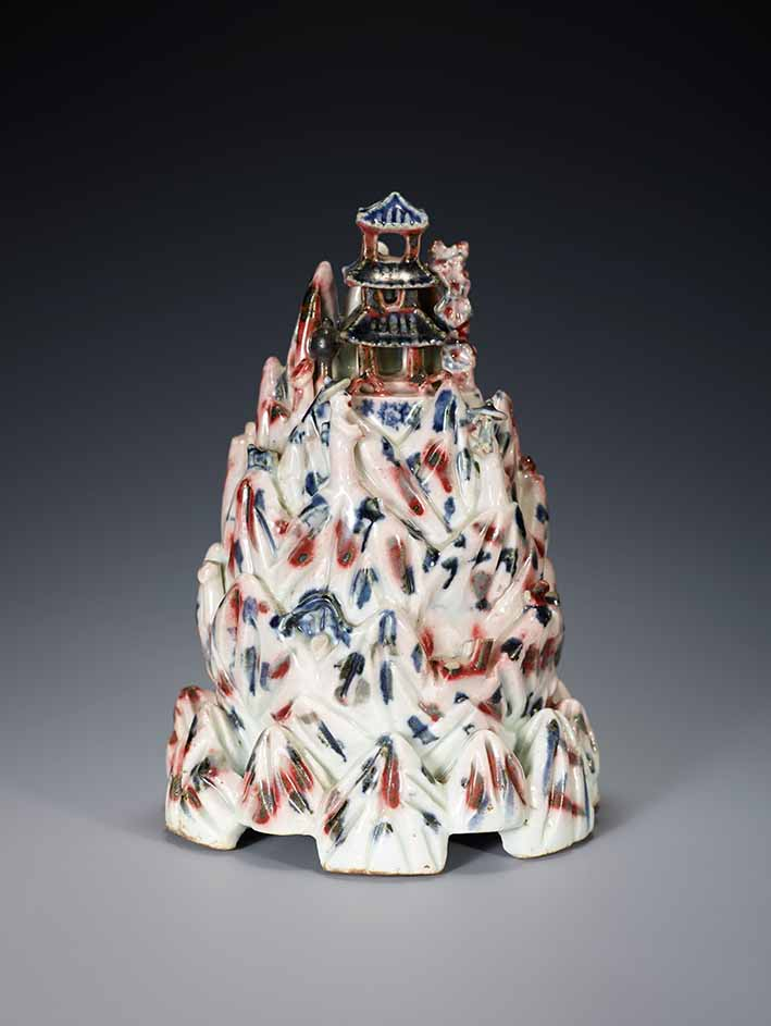 Water dropper in the shape of Mt. Geumgang Korea, mid-19th century, unidentified artist, porcelain painted with cobalt-blue and copper-red, 17.5 x 12.5 x 12.5 cm, lent by Leeum, Samsung Museum of Art