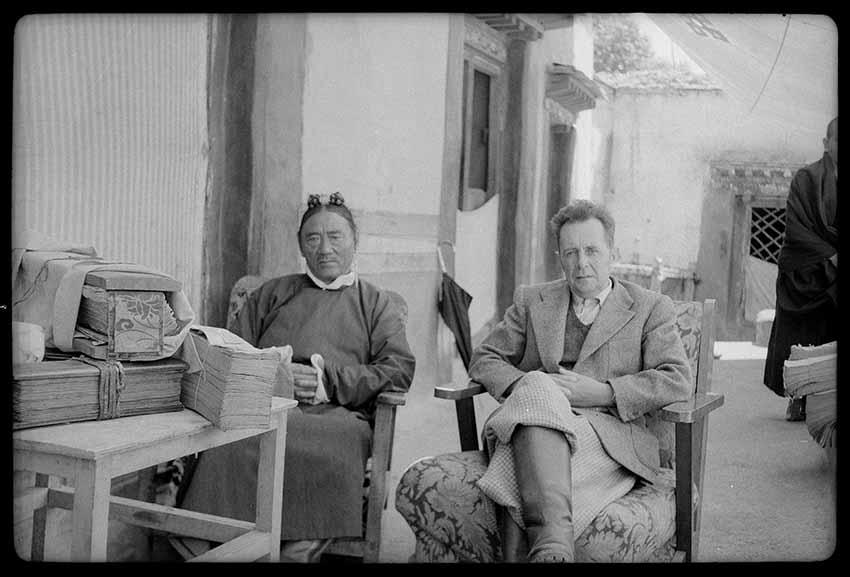Giuseppe Tucci and Tsarong, Tibetan Minister of Finance for Chushul, August 1948. Tucci was consulting Tsarong's personal library. Lhasa, U, Tibet. Prodhan, 1948. Courtesy of Istituto Italiano per l'Africa e l'Oriente (Is.I.A.O.) in l.c.a. and Ministero Degli Affari Esteri e della Cooperazione Internazionale