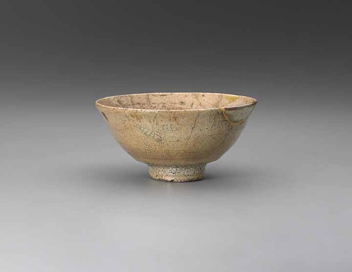 Tea bowl, Korea, Joseon dynasty (1392-1910), 16th century, glazed stoneware repaired with gold lacquer and fragments of Kohiki ware (Ido ware), lent by Peggy and Richard M Danziger