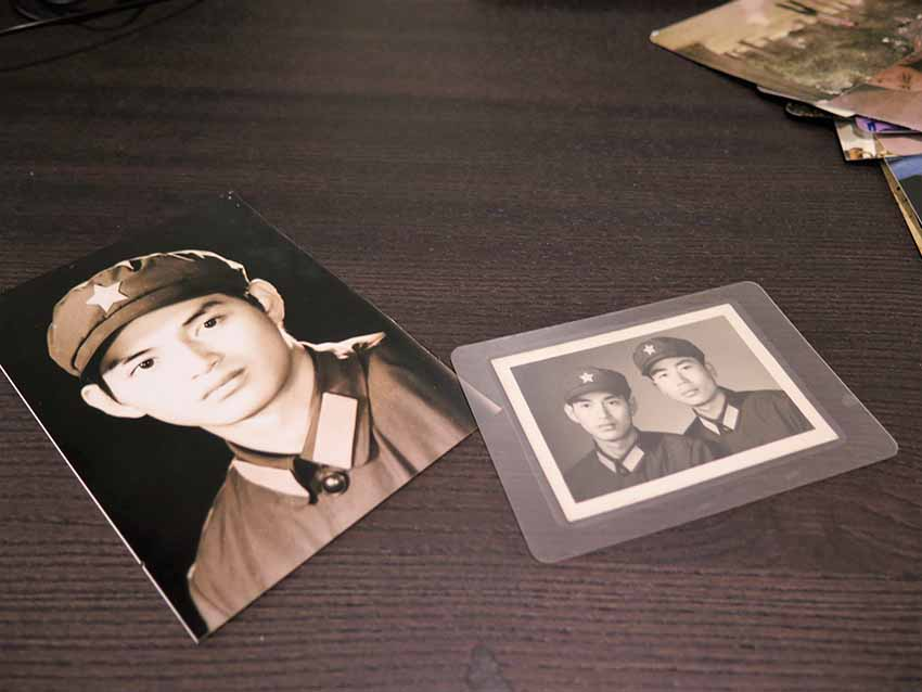 Photographs of Guo Jian when he was 17 years old and a member of the People's Liberation Army. In the photograph showing two men, Jian is on the left