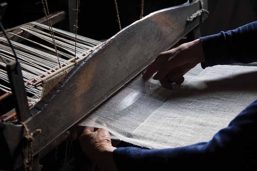 Wu Meitz weaving on her loom