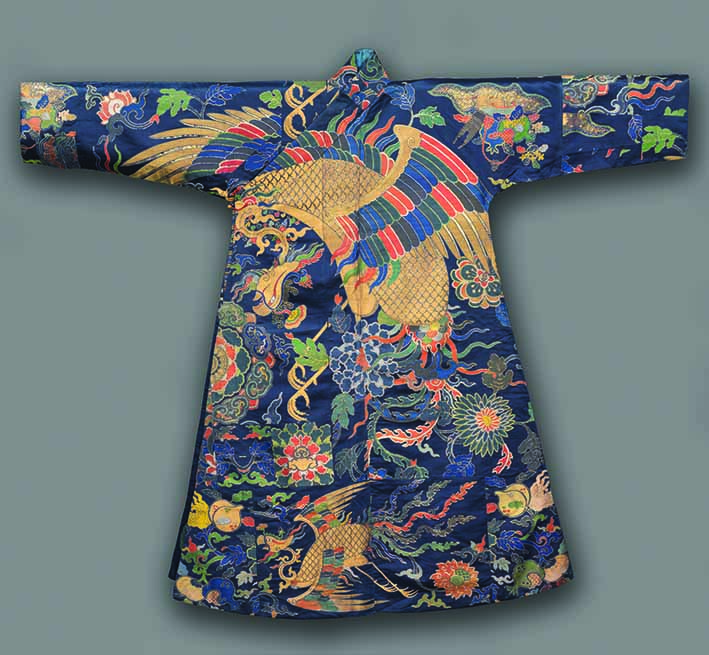 Tibetan Man's Robe, chuba, late 1600s, China, Qing dynasty (1644-1911), Kangxi period (1662-1722), 17th century, satin weave with supplementary weft patterning; silk, gilt-metal thread and peacock-feathered thread, overall dimensions 162.6 x 191.8 cm, The Cleveland Museum of Art, purchase Norman O Stone and Ella A Stone Memorial Fund