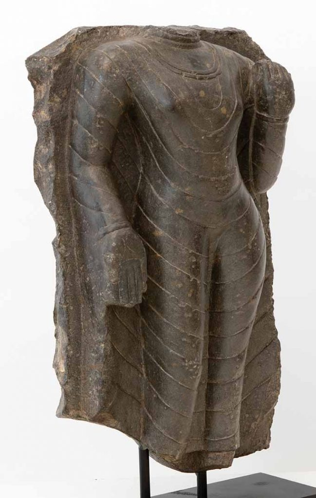 Black stone torso of a standing Buddha, Northeast India, probably Bihar, Pala period, 9th/10th century, height 61 cm, Tucker Tozer Asian Art