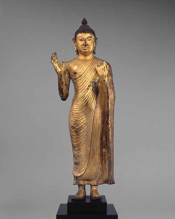 Standing Buddha, 10th century, copper alloy with gilding, 23 ¾ × 7 × 4 inches, The Metropolitan Museum of Art, New York, gift of Enid A Haupt, 1993