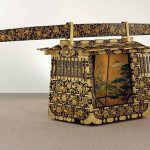 Bridal Palanquin with arabesque foliage, wild ginger leaves, and family crests, 1856m Edo period (1615-1868), lacquered wood with gold and silver hiramaki-e and silvered copper fittings; interior paintings: ink, colour, and gold on paper; blinds: bamboo and silk; window screens: silk. Compartment: H. 50 ¾ in, W. 54 3/16 in, D. 38 1/8 in. Carrying beam: H. 7 in, W. 15 ft. 8 in, D. 2 7/8 in. Arthur M Sackler Gallery, Smithsonian Institution