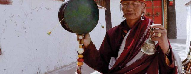Monk drumming at Lukhang temple. Photo © David Bickerstaff