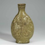 Celadon Flask with foreigner (huren) and lions, Northern Qi dynasty (550-577), porcelain, height 28.25 cm, diam. (max) 16.5 cm, diam. at mouth 5.7 cm, unearthed in 1956 at Yumengou in Taiyuan, Shanxi. Collection of the Shanxi Museum