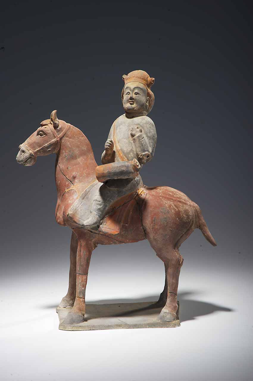 Mounted Drummer from a tomb dated to the Northern Qi dynasty, second year of Wuping (571), earthenware with pigments, height (total) 28.5 cm, (horse) 26 cm, length 23.1 cm.Unearthed in 2000 from the tomb of Xu Xianxiu at Wangjiafeng village in Taiyuan, Shanxi. Collection of the Shanxi Museum