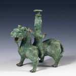Vessel in the shape of a man astride a beast, Southern Dynasties period (420-589), bronze, height (total) 19.36 cm, width 19 cm. Acquired from the Guan family in Tangzijie, Nanjing. Collection of the Nanjing Museum
