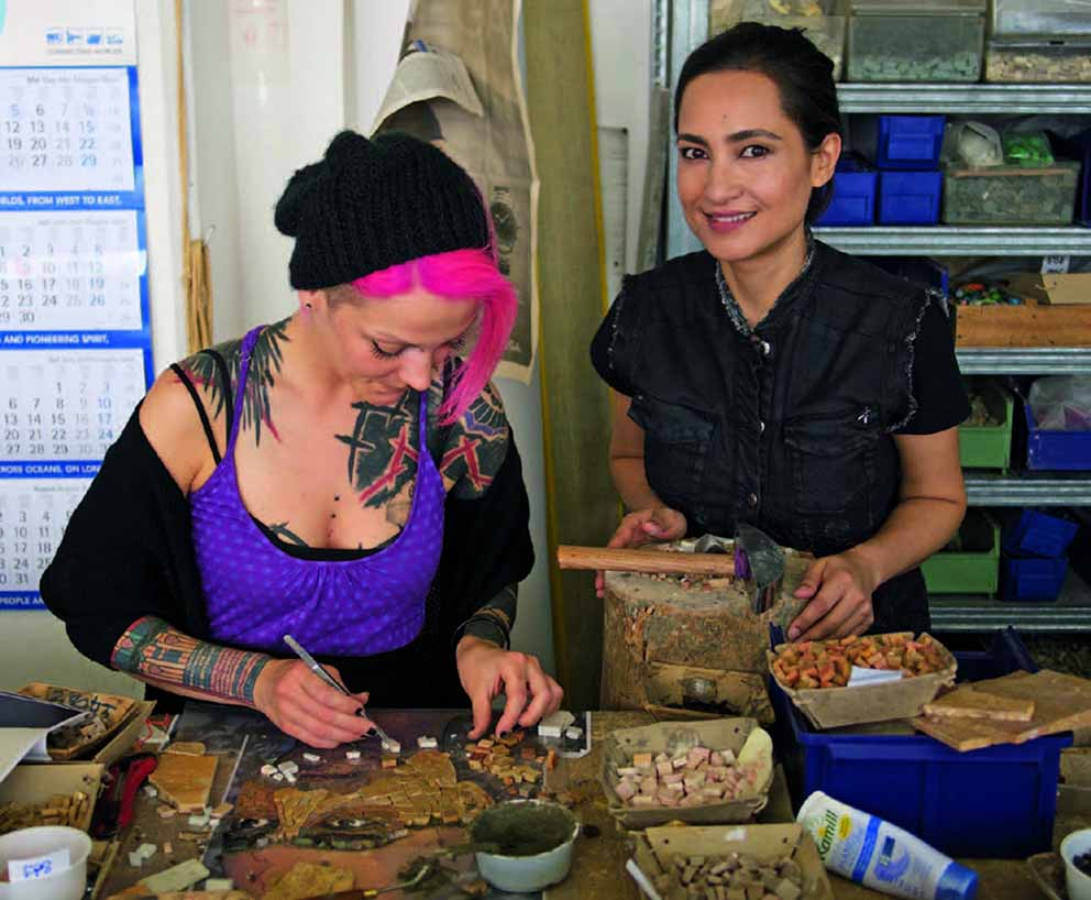 Shahzia Sikander and an artisan from Mayer of Munich working on the mosaic in Germany. The window was created by handpainting ceramic colours within thin layers of glass, a technique pioneered by Mayer of Munich, specialising in stained glass and mosaics, with whom Sikander collaborated on both projects